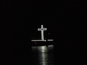 the white cross in the boat light parade