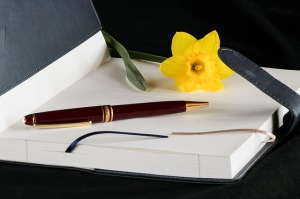 blank journal, pen, flower