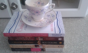 flowered tea cup atop novels, Cookie Encounter