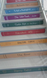 classics painted on stairs at O'Fallon, IL library
