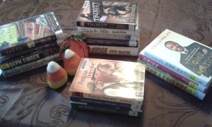 piles of library books with fall decor