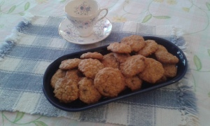 tea cup, platter of homemade oatmeal chocolate chip cookies